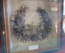 Women used to brush their hair up to a 100 strokes per day and collect the loose hair. When they had enough items like this wreath were created with the hair.