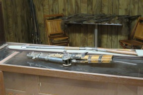 This gun looks like an old wheel lock shotgun and is made from parts of real weapons but should not be fired since its creator may have been less than careful about how it is assembled.