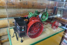 This is a working steam engine replica of a Case tractor and is referred to as a freelance traction engine.